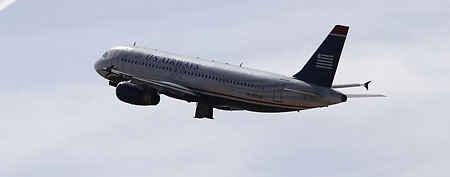 Three US Airways commuter reportedly came within seconds of a midair collision near Ronald Reagan International Airport. (Joshua Lott/Getty Images)