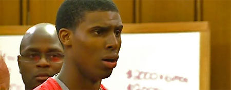 Basketball recruit Tony Farmer collapses to the courtroom floor after being handed a three-year prison term. (Screengrab via Yahoo! Sports Blogs)