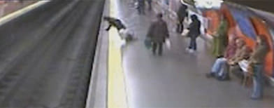 Woman saved from train tracks