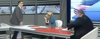 Heated television debate turns violent