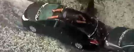 Man desperately tries to protect his car