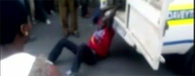 Police van drags man to his death