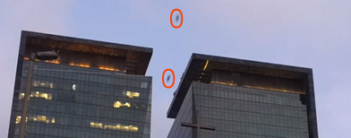 Crazy daredevils glide between buildings