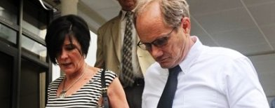 Rick Todd (right) and his wife Mary walk out of the Subordinate courts in Singapore on Tuesday. Their walk out came after their star witness, a US pathologist who never examined the body, came under intense questioning for saying Shane Todd may have been killed by assassins after quitting a high-tech project for two Asian firms (AFP Photo)