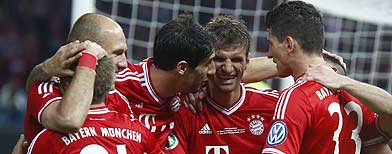 Dramatic win hands Bayern historic treble