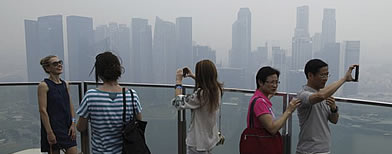 "Choking smog descends over various parts in Singapore as the PSI index hits ""unhealthy"" levels."