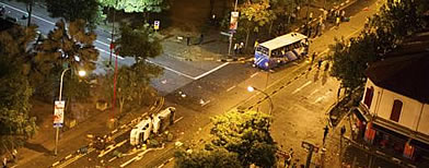 5 police vehicles and one ambulance are damaged after a fatal accident triggers a riot in Little India.
