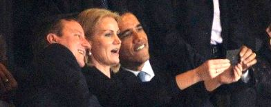 obama snaps a selfie at mandela s memorial while the president is