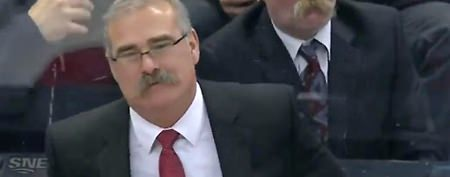 Creepy doppelganger sits behind coach