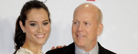 Bruce Willis plants a big one on his wife