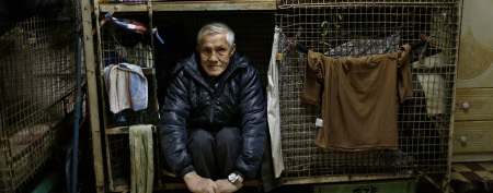 Wealthy city's poor forced to live in cages
