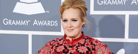 Adele nearly upstaged by mystery man