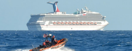 A small boat belonging to the Coast Guard Cutter Vigorous patrols near the cruise ship Carnival Triumph in the Gulf of Mexico. (AP)