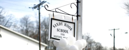 A sign outside Sandy Hook Elementary in Newtown, Conn. A month after the shooting spree at the school left 26 people, including 20 children, dead, residents there are wondering what to do with the school building. (Eric Thayer/Reuters)