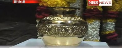 Devotee offers 1 gold pot worth 32 lakh