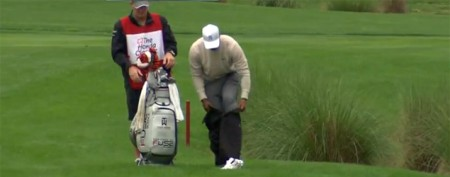 Tiger Woods changes clothes for tricky shot