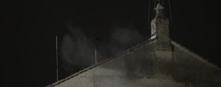 Black smoke signals no Pope on first day