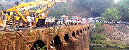 Bus plunges off bridge in India