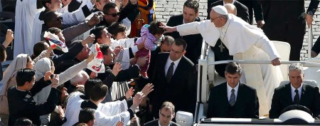 Francis officially begins his papacy