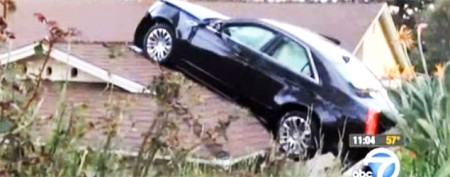 Strange story behind car on neighbor's roof