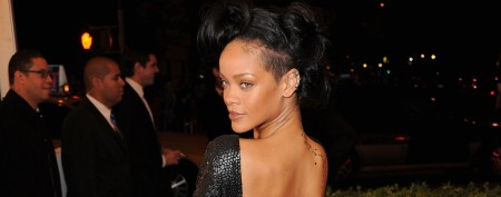 Rihanna heats up red carpet by covering up