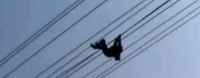 Drunk man hangs on high voltage wire