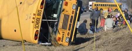 School bus overturns in harrowing crash