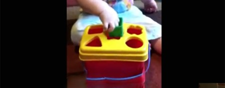 Toddler outsmarts shape-sorting game