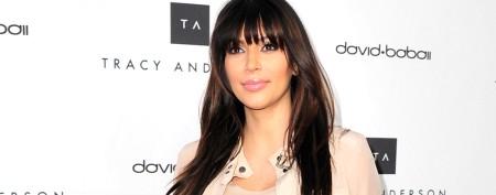 Kim Kardashian bares her growing baby bump