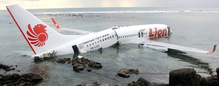 Plane overshoots runway, crashes into sea