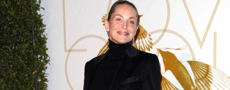 Sharon Stone locks lips with '90s model