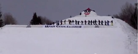 30 freestyle skiers pull off wild stunt