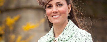 Kate Middleton shows off growing bump