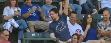 Fan's dangerous reach for a foul ball