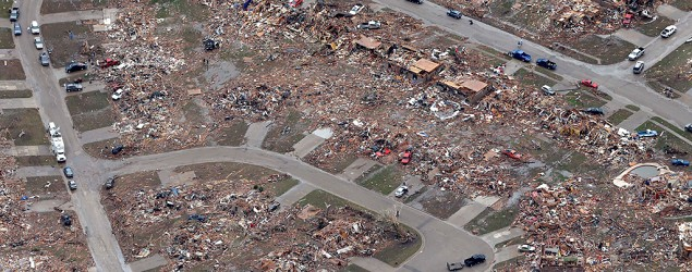 An aerial view shows an entire neighborhood destroyed by a tornado in Moore, Oklahoma.  (AP/Tony Gutierrez)