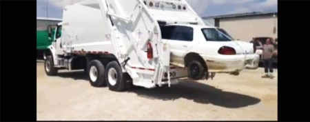 Garbage truck swallows car in video