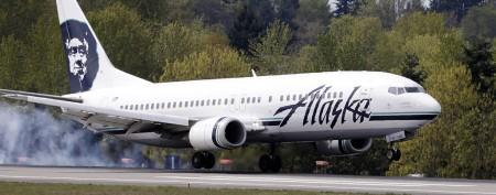 Man tries to open airplane door in flight