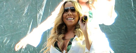Mariah Carey goes retro in belly-baring stage getup
