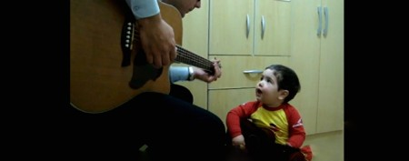 Father and son sing adorable duet