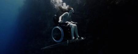 Woman in wheelchair feels freedom underwater