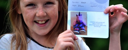 Girl uses toy unicorn's passport at airport