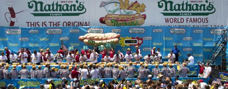 Hot dog champ wolfs down record for the win