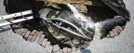 Car gets caught in Ohio sinkhole