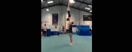 Amazing cheerleading toss just keeps going
