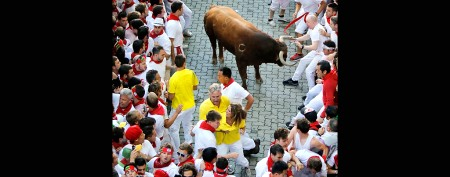 Can you spot NFL coach running with bulls?