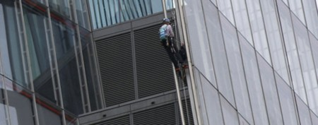 Activists scale 1,017-foot tower