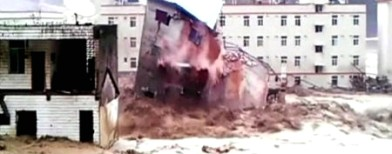 Video: Floods bring down buildings in China