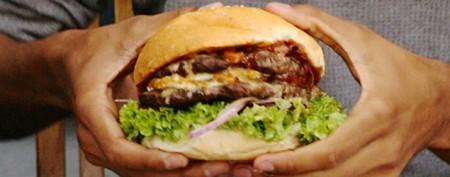 Calorie-bomb burger challenge: 'Shove it all in'