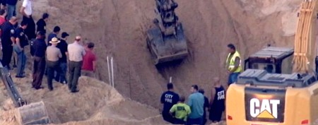 Boy trapped for hours in massive sand dune