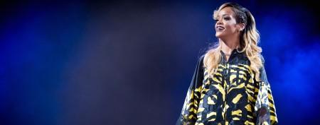 Rihanna flashes diamond-encrusted teeth
